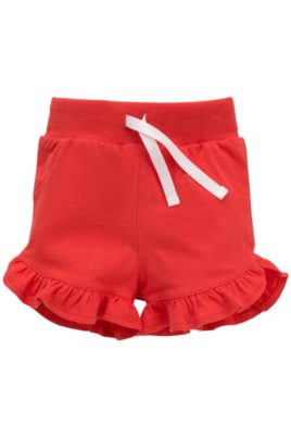 Pinokio Baby Sommer rote kurze Hose Shorts mit Rüschen, Kordel & elastischem Taillenbund für Mädchen – Sommerhose Baumwollshorts Schlupfshorts Schlafshorts unifarben Kinderhose – Vorderansicht